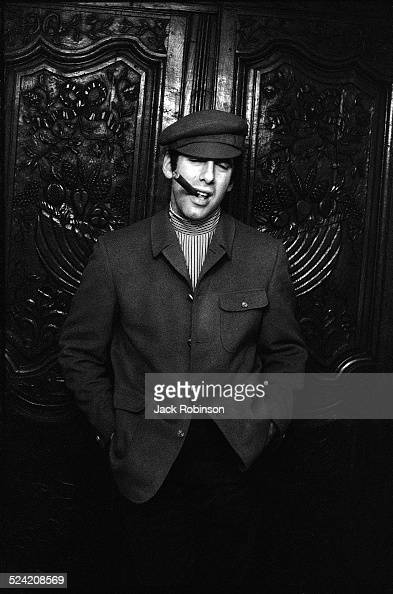 Portrait of American actor Elliott Gould as he poses hands in his pockets and a cigar in his mouth New York New York December 1968