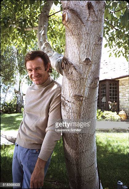 Portrait of American actor Gene Hackman as he leans against a tree California 1972