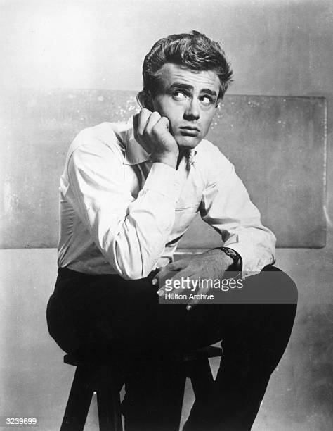 Portrait of American actor James Dean on the set of director Elia Kazan's film 'East of Eden'
