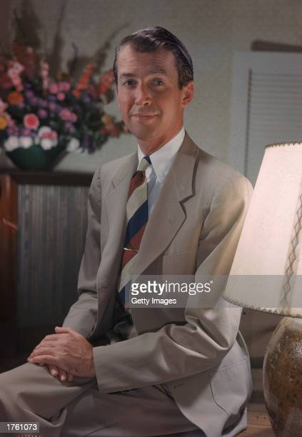 Portrait of American actor Jimmy Stewart seated wearing a tan suit 1940s