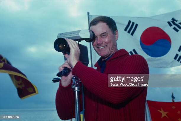 Portrait of American actor Larry Hagman as he poses with a videocamera near his home Malibu California January 1980