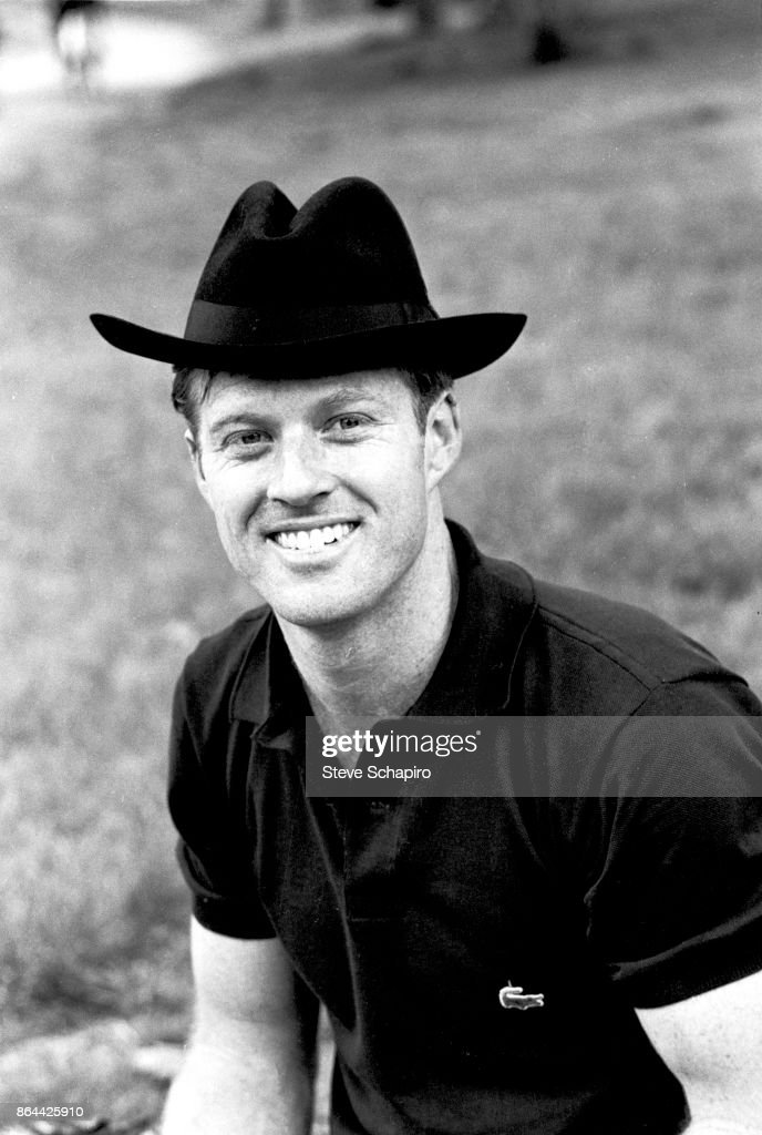 Portrait of American actor Robert Redford, in a black hat, as he smiles in Central Park, New York, New York, 1966.