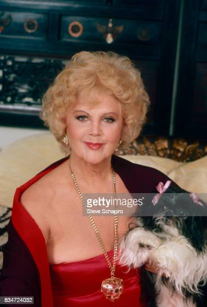 Portrait of American actress and acting teacher Stella Adler as she poses with her dog Los Angeles California August 1982