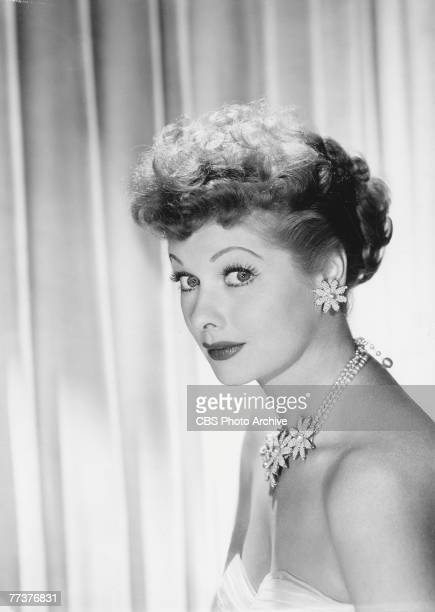 Portrait of American actress and comedienne Lucille Ball 1955 She has bare shoulders and wears a matching set of a jeweled necklace and earrings