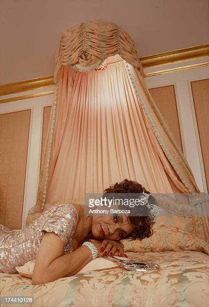 Portrait of American actress and singer Eartha Kitt as she poses on a bed in a room at the Plaza Hotel New York New York 1992