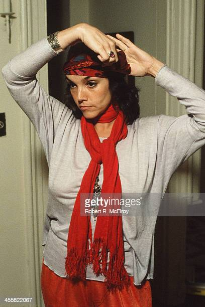 Portrait of American actress Brooke Adams at home as she adjusts her headband New York New York 1987