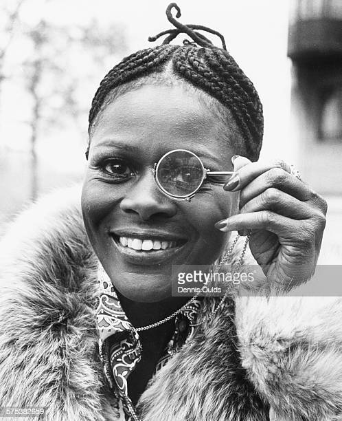 Portrait of American actress Cicely Tyson holding a monocle to her eye during a visit to London February 19th 1973