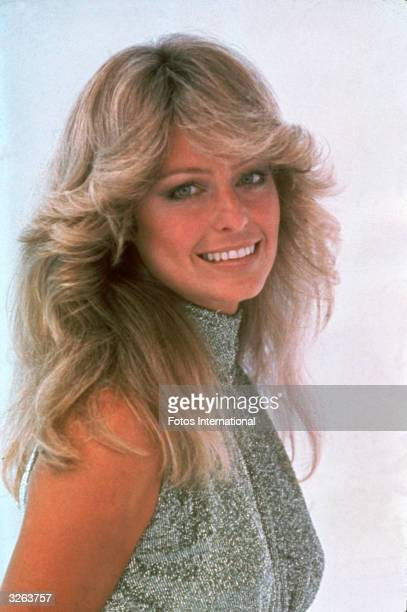 Portrait of American actress Farrah Fawcett dressed in a highnecked sleeveless outfit June 1977