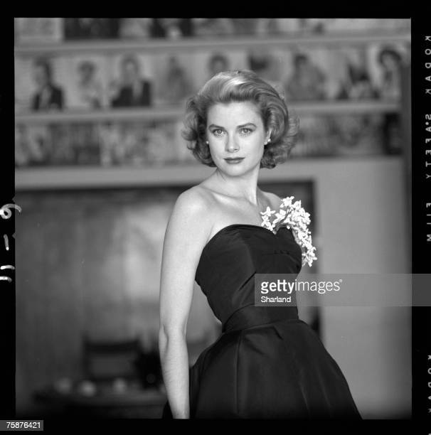 Portrait of American actress Grace Kelly in a strapless gown with a sprig of flowers tucked into her bodice Hollywood California March 1954