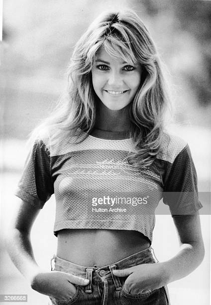 Portrait of American actress Heather Locklear dressed in jeans and a cropped sports jersey late 1970s