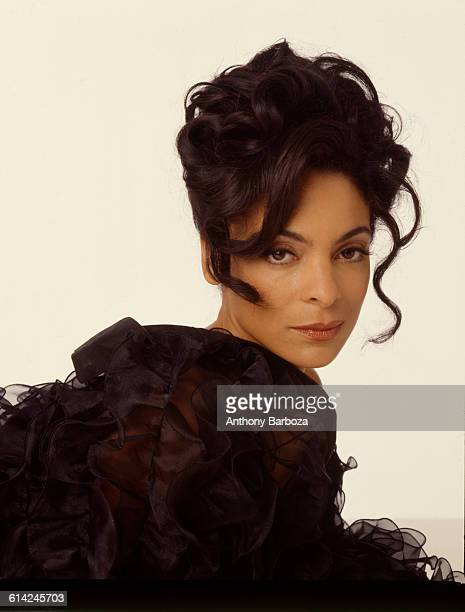 Portrait of American actress Jasmine Guy dressed in black as she poses against a white background New York 2000