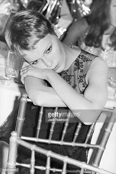 Portrait of American actress Mia Farrow as she attends a party in celebration of the 25th marriage anniversary of Betty Comden and her husband Steve...