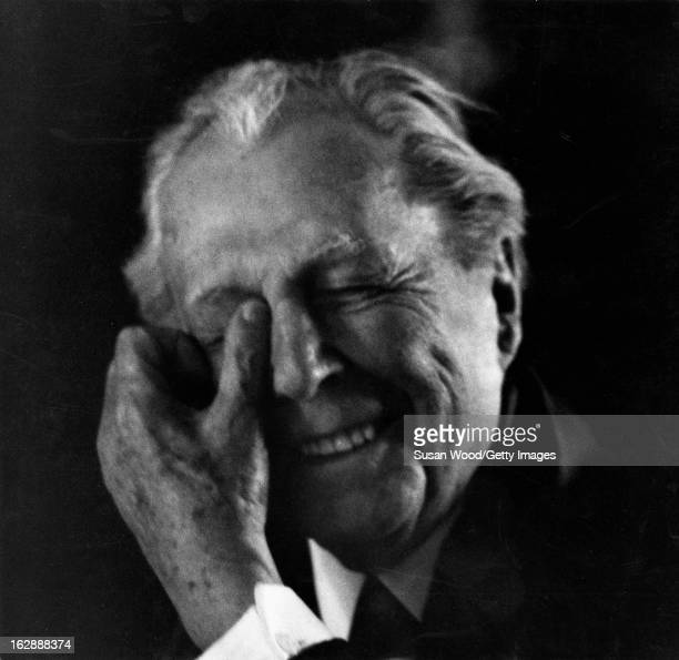 Portrait of American architect Frank Lloyd Wright as he laughs one hand to his head 1956