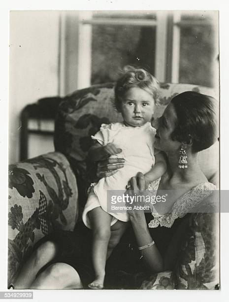 Portrait of American art collector and socialite Peggy Guggenheim as she holds an unidentified child 1926