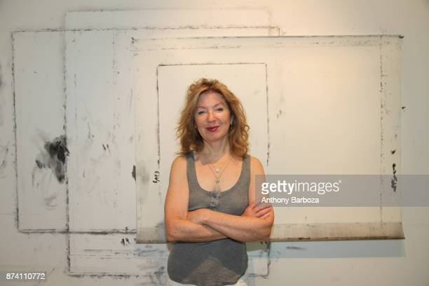 Portrait of American artist April Gornik as she poses in her studio Sag Harbor New York 2011