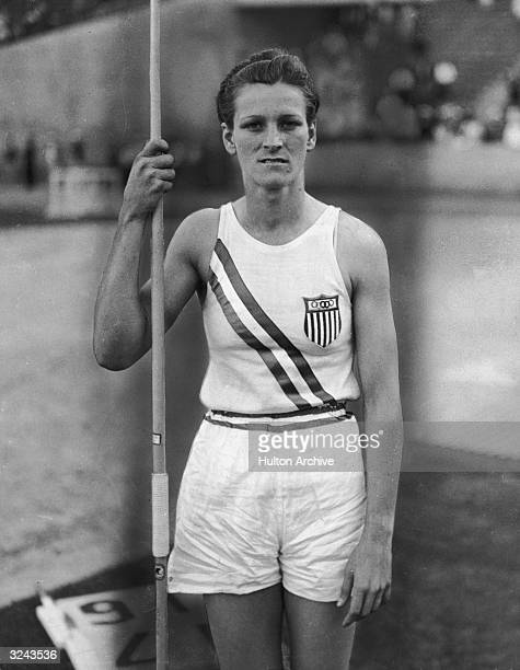 Portrait of American athlete Babe Didrikson Zaharias holding a javelin and wearing her Olympic uniform Los Angeles California Babe saet a new world...