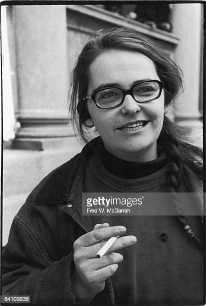 Portrait of American author and activist Kate Millett as she holds a cigarette and gives a crooked smile New York New York March 28 1970