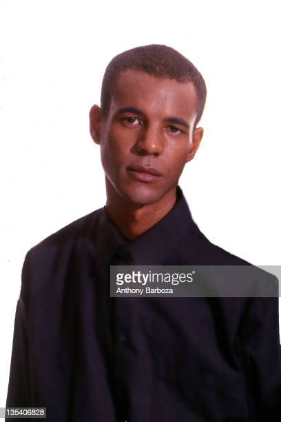 Portrait of American author Colson Whitehead as he poses against a white background New York New York 2002