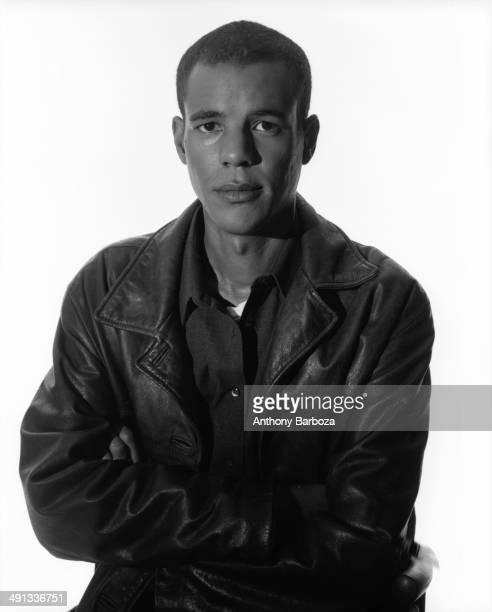 Portrait of American author Colson Whitehead as he poses against a white background New York New York 1999