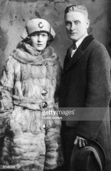 Portrait of American author F Scott Fitzgerald and his wife Zelda wearing winter coats