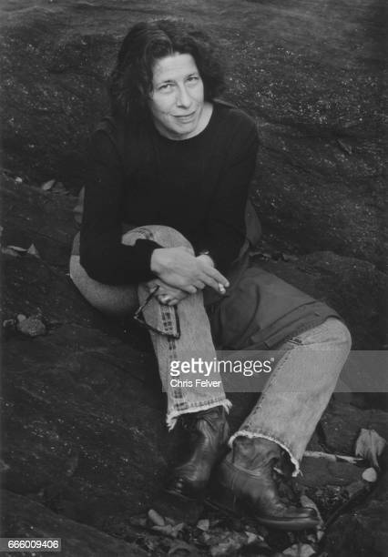 Portrait of American author Fran Lebowitz as she sits on a rock New York New York 2010