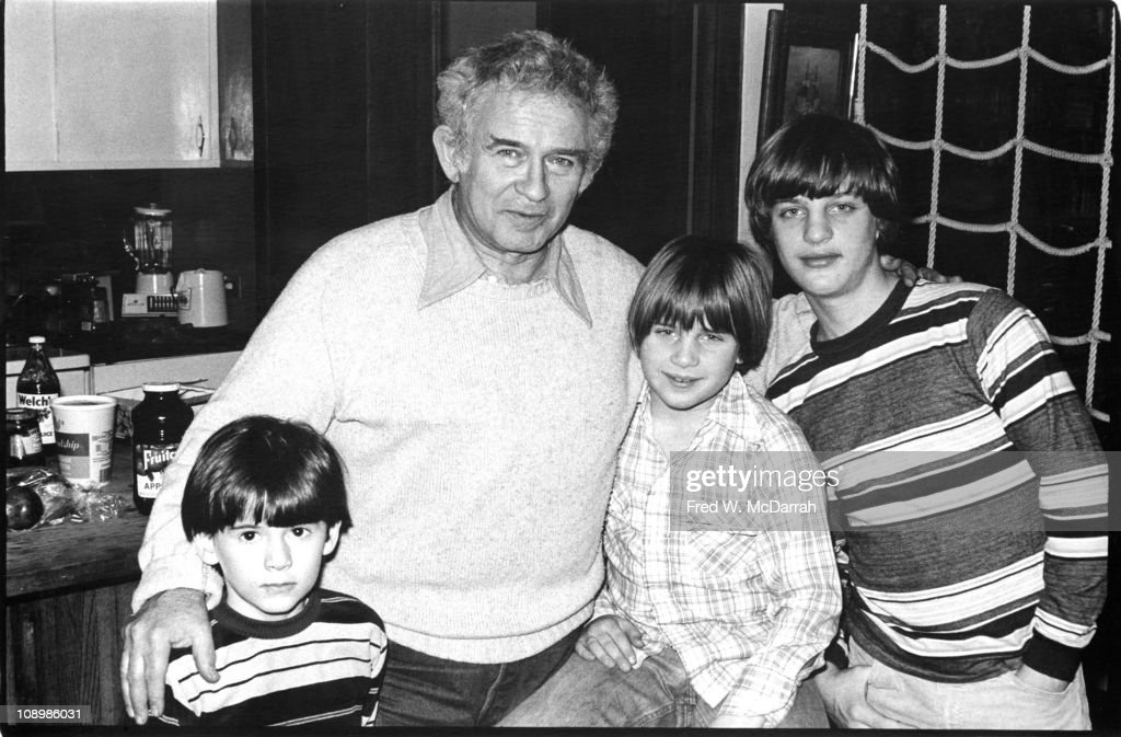 Portrait of American author Norman Mailer (1923 - 2007) as he poses with his sons Matthew, Stephen, and Michael, in their home, New York, New York, January 5, 1978.
