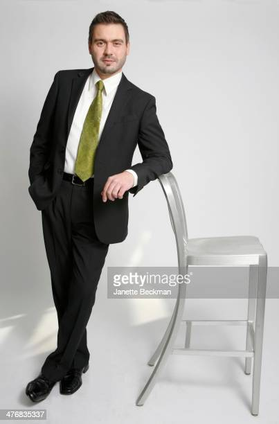 Portrait of American baritone Mischa Bouvier against a white background as he leans on a chair New York New York December 4 2010