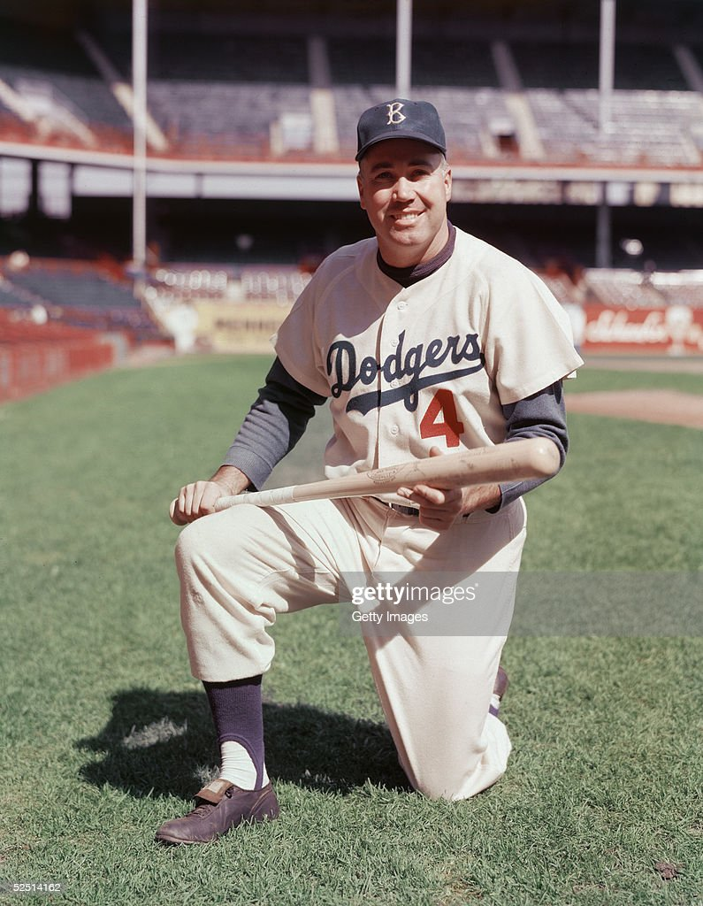 Portrait of American baseball player Duke Snider, center fielder for the Brooklyn Dodgers, as he poses on one knee in his uniform, a baseball bat in his hands, late 1950s.