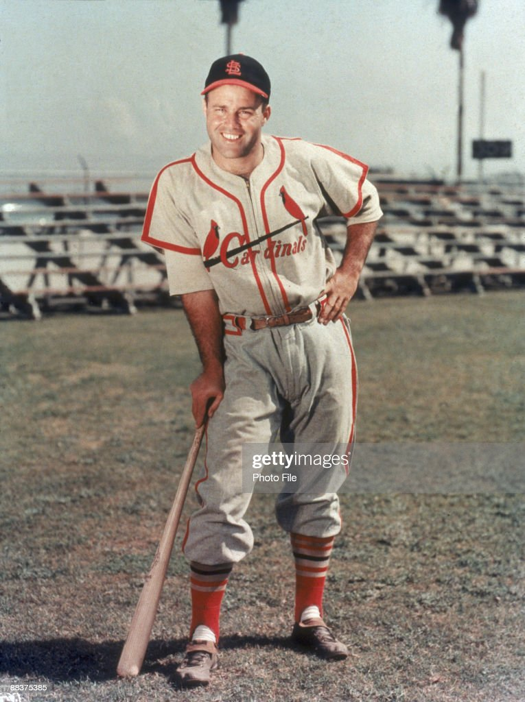 Portrait of American baseball player Joe Garagiola of the St. Louis Cardinals as he leans on a baseball bat, late 1940s.