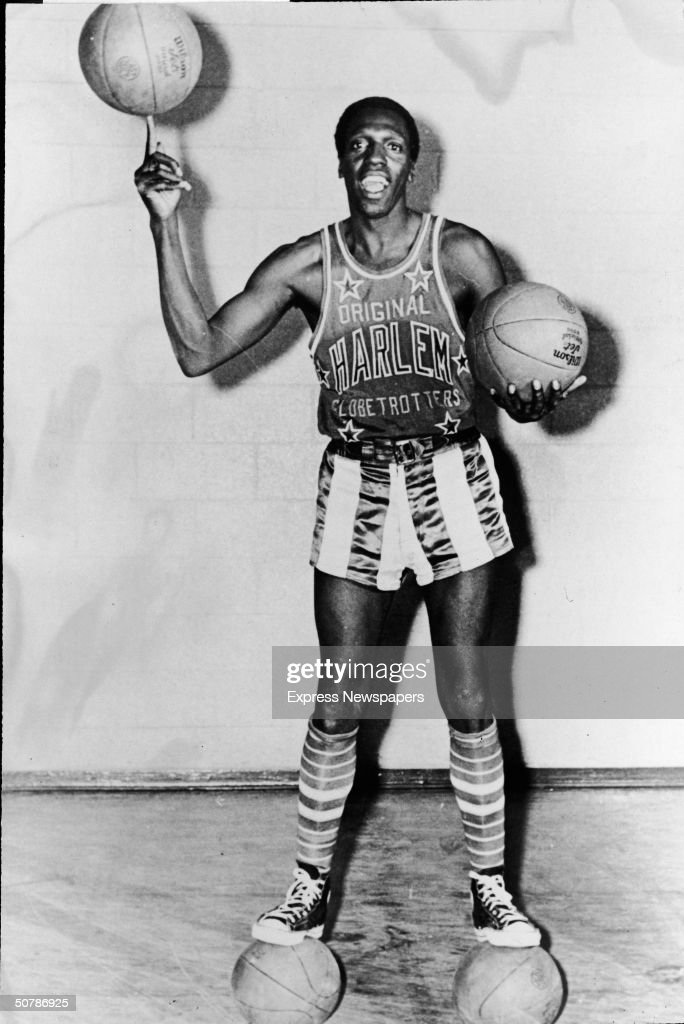 Portrait of American basketball player Meadowlark Lemon of the Harlem Globetrotters balancing a basketball on his finger, May 15, 1968.