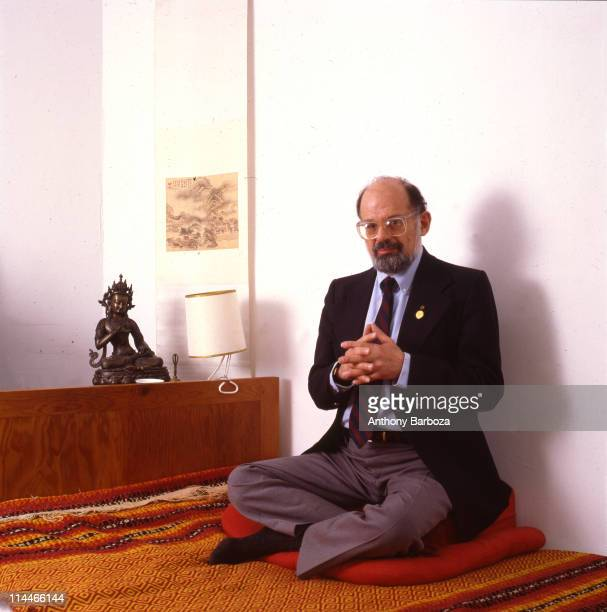 Portrait of American Beat poet Allen Ginsburg as he sits crosslegged on a bed New York New York 1987