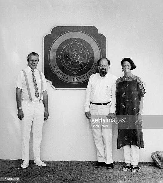 Portrait of American Beat poets from left Peter Orlovsky Allen Ginsberg and Anne Waldman as they pose in front of the Naropa Institute emblem Boulder...