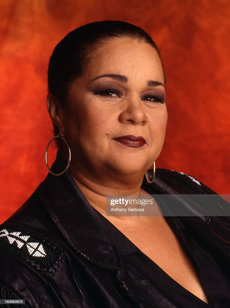 Portrait of American blues and jazz singer <a gi-track='captionPersonalityLinkClicked' href=/galleries/search?phrase=Etta+James&family=editorial&specificpeople=833123 ng-click='$event.stopPropagation()'>Etta James</a> (born Jamesetta Hawkins, 1938 - 2012) as she poses against an orange background, Los Angeles, California, 1995.