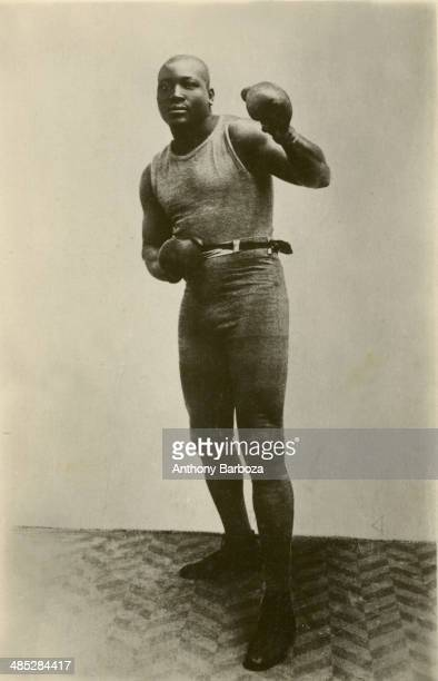 Portrait of American boxer Jack Johnson as he poses in a fighting stance 1900s