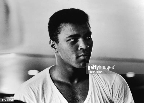 Portrait of American boxer Muhammad Ali in a tshirt early 1960s