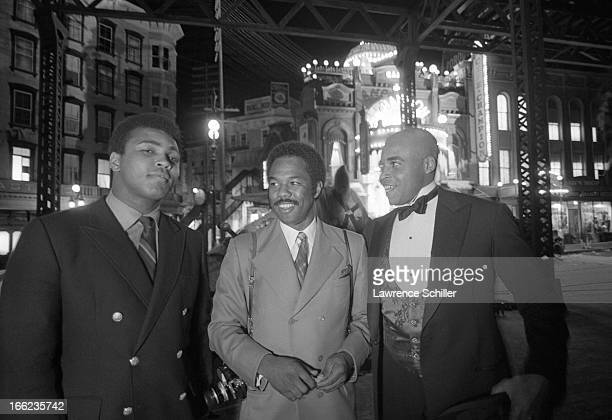 Portrait of American boxer Muhammad Ali photogragher Howard Bingham and actor James Earl Jones as they pose on the set of the film 'The Great White...