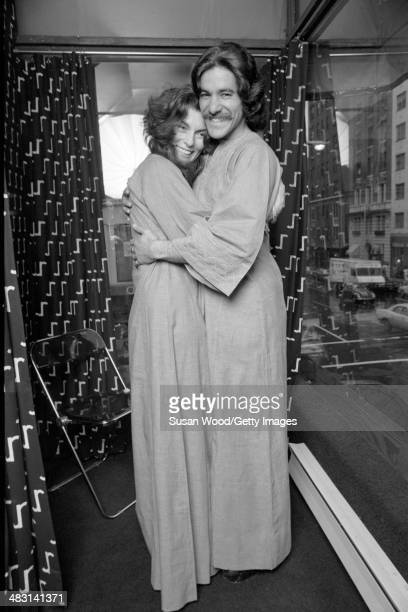 Portrait of American broadcast journalist Geraldo Rivera and fashion designer Jackie Rogers as they pose in matching robes January 1970