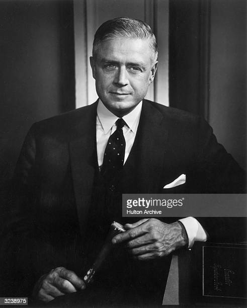 Portrait of American business executive Thomas J Watson Jr President of International Business Machines Corporation [IBM] leaning against an...