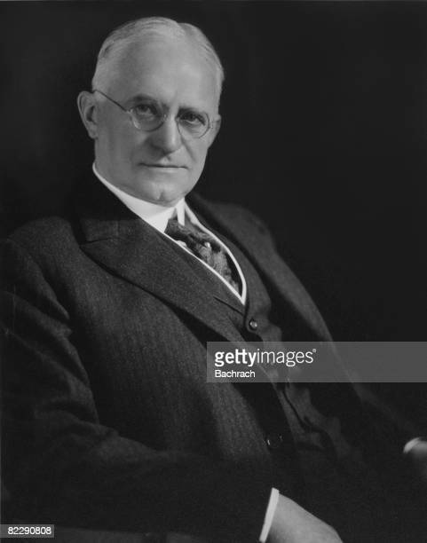 Portrait of American businessman and philanthropist George Eastman as he sits in a chair 1920s He founded the Eastman Kodak Company in 1988
