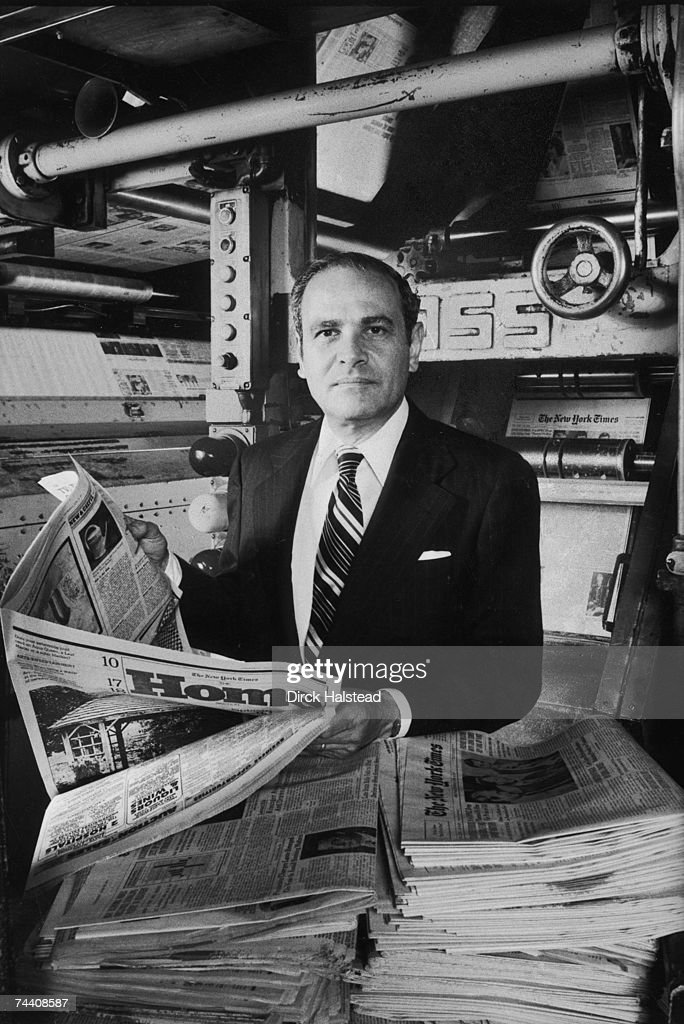 Portrait of American businessman and publisher of the New York Times Arthur Ochs Sulzberger as he stands in front of a printing press in a print room...