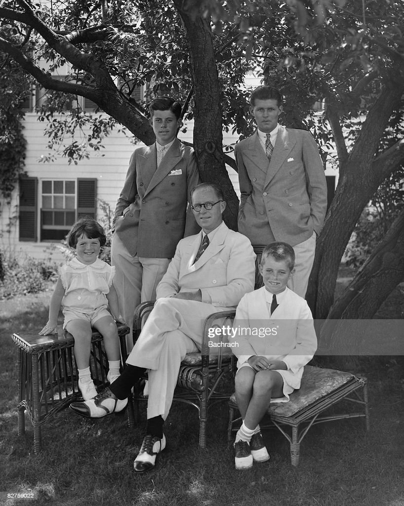 Portrait of American businessman Joseph P Kennedy Sr (1888 - 1969) (seated, center) as he poses with his sons around him, clockwise from left, Edward Kennedy, John F Kennedy (1917 - 1963), Joseph P Kennedy Jr (1915 - 1944), and Robert Kennedy, Hyannis, Massachussetts, 1930s.