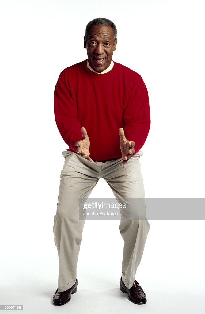 Portrait of American comedian and actor <a gi-track='captionPersonalityLinkClicked' href=/galleries/search?phrase=Bill+Cosby&family=editorial&specificpeople=206281 ng-click='$event.stopPropagation()'>Bill Cosby</a>, dressed in a red sweater and khaki pants, October 2005.
