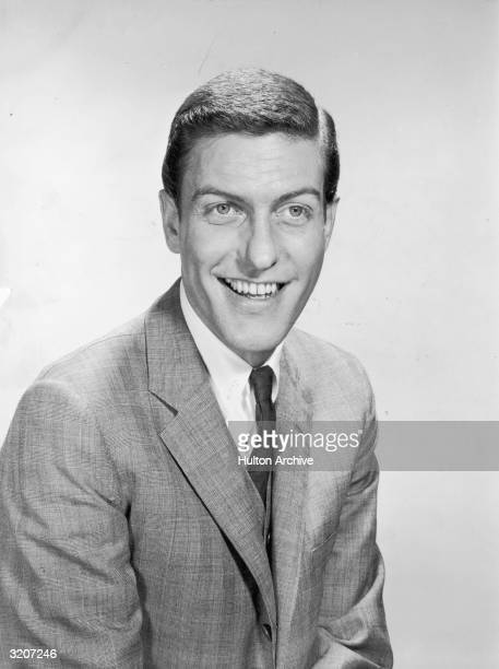 Portrait of American comedian and actor Dick van Dyke smiling in a suit and tie