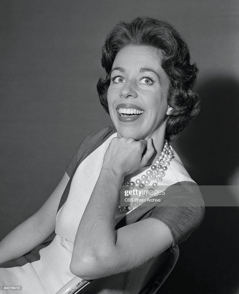 Portrait of American commedienne <a gi-track='captionPersonalityLinkClicked' href=/galleries/search?phrase=Carol+Burnett&family=editorial&specificpeople=206201 ng-click='$event.stopPropagation()'>Carol Burnett</a> as she smiles broadly with her hand on her chin, backstage at 'The Garry Moore Show,' New York, New York, June 1960.