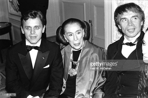 Portrait of American dancer and choreographer Martha Graham flanked by Russianborn dancers Mikhail Baryshnikov and Rudolf Nureyev at an event in her...