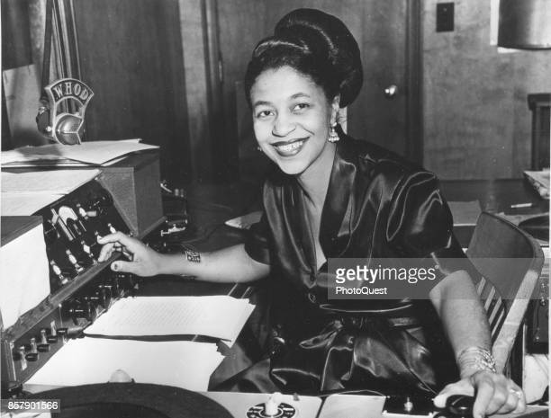 Portrait of American disc jockey Mary 'Dee' Dudley sits at the controls in a studio of radio station WHOD Pittsburgh Pennsylvania 1956 She is widely...