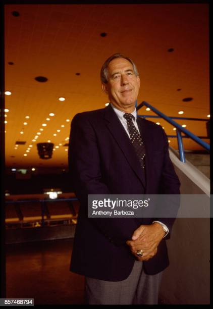 Portrait of American educational administrator University of Kentucky athletic director Charles Martin 'CM' Newton as he poses in a sports arena on...