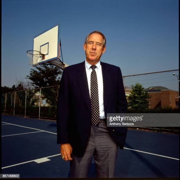 Portrait of American educational administrator University of Kentucky athletic director Charles Martin 'CM' Newton as he poses on a basketball court...