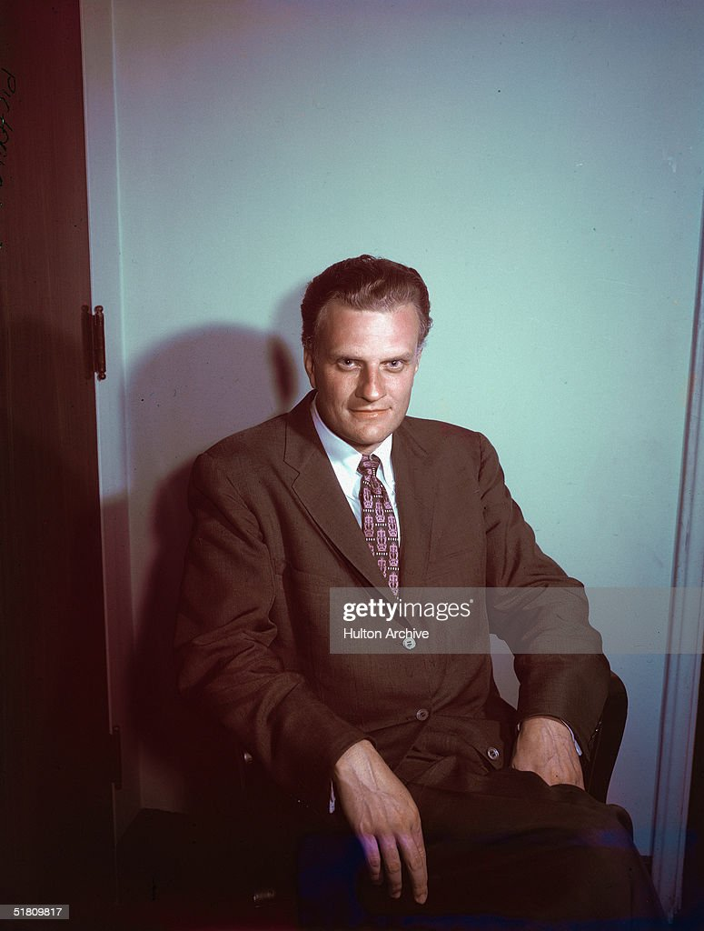 Portrait of American evangelist <a gi-track='captionPersonalityLinkClicked' href=/galleries/search?phrase=Billy+Graham+-+Evangelist&family=editorial&specificpeople=167098 ng-click='$event.stopPropagation()'>Billy Graham</a> sitting on a chair, early 1960s.