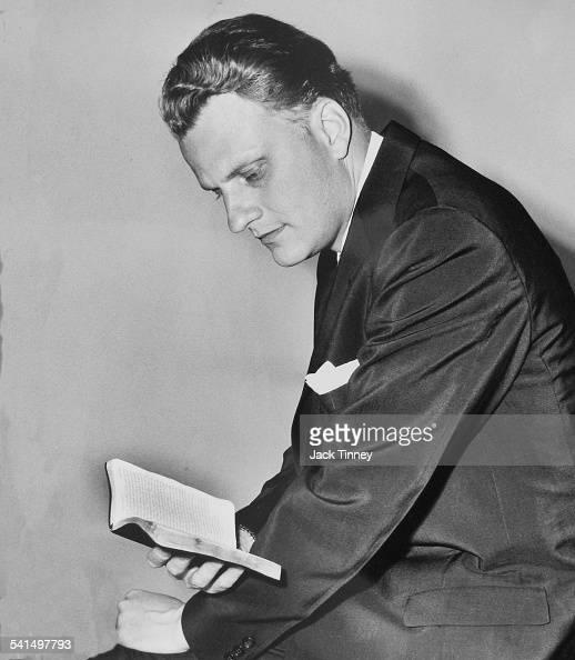 Portrait of American evangelist Reverend Billy Graham as he reads Philadelphia Pennsylvania 1960